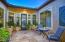 Private courtyard with stamped concrete and custom glass door