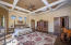 Enormous elegant master suite with Cantera gas fireplace, wood floors, sitting room, and access to patio.