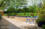 The 1.4 acre grounds are detailed with an award winning landscaping design from the signature front courtyard to the lush backyard..