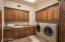 A generous size laundry room with an abundance of cabinetry.