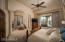 A spacious owner's retreat and office is split from the three en suite guest rooms