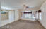 Living room and view of dining room. Nice ceiling fans used when the newer HVAC unit is not needed