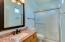 Master bathroom has brand new shower doors