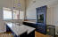 Game room kitchen with dishwasher, kegerator, microwave, fridge