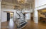 Enter the two story grand entry with its signature staircase