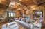 Rich, wood paneled downstairs office with fireplace that looks out to the front and backyard