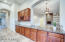 Expansive Granite Countertop with Bar Sink and Wine Rack