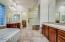 Master Bath features dual sink vanities and walk-in shower