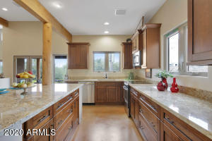 Kitchen Island and Massive amount of Granite counter tops and cabinets.