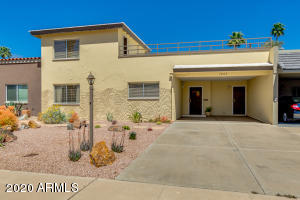 In true mid-century Arizona syle, there is a single carport that also serves as an entry to the home.