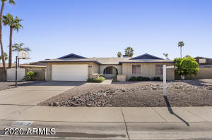 Great ranch style home in Chandler with large lot, RV gate and Pebbletec pool.