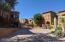 Tuscan inspired landscape, pavered driveways.