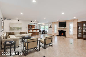 "20"" neutral Porcelain tile! Surround sound, newer granite fireplace! Furniture virtually staged."