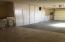 Floor to ceiling cabinets in garage.