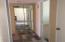 Hallway to bath & bedrooms.