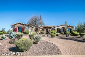 Paved circular driveway, side entry garage and notable architectural detailing make this homes curb appeal impressive!