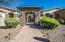 Stone encased entry gate ushers you into the private courtyard.