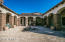 Expansive courtyard with Cantera fountain and fireplace and ample covered patio spaces.