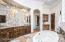 Beautiful custom tile work showcases the vanity wall.
