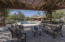 CLOSEST TO THE HOUSE IS THE PERGOLA, W/BUILT IN BBQ, FIRE PIT, MISTERS, CITRUS TREES, SURROUND SOUND