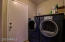 Laundry Room with Frontload Washer & Dryer on Pedestals