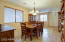 Dining room offers plenty o.f space for a large size group
