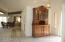 The beauriful antique cabinet in the foyer is available outside of escrow. It graces this space perfectly!
