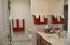 The guest bath has a walk-in shower plus a linen closet hiding behind the entrance door.