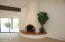 """The beehive fireplace has a raised hearth covered with 4x4"""" Saltillo tile."""