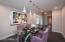 Formal dining room w/custom lighting.