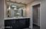 Master bath w/dual vanities & pocket door to bedroom