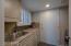Laundry room w/granite, sink, window & new LG washer/dryer & access to garage