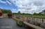 Spacious back patio w/wrought iron fence to enjoy the view