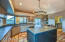 Gourmet country kitchen w/cabinets, butler's pantry, island, counter space....a cooks delight!