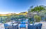 Terraced decks lead to swimming pool