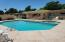 Community Pool With Lots of Seating. Close to Property.
