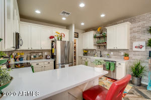 The kitchen was updated in 2016. Cabinets, counter tops, appliances, farm house sink flooring, and back splash!