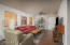 Streamlined great room with original stained concrete floors