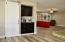Wide open floorplan with coffee bar between kitchen and the huge family room with built-ins.