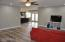 The large family room is entered from the 2 car garage and provides 3 walls that can hold media without impeding the traffic walking by.