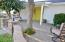 The front courtyard and yellow front door with sidelight welcome your family and friends.