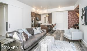 The spacious open concept living room helps this condominium live large.
