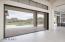 Window wall to backyard with golf and mountain views