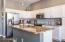 Light cabinets, breakfast bar open to great room