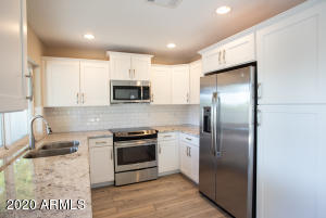 Beautifully updated Kitchen with Stainless Steel Appliances and Granite Countertops