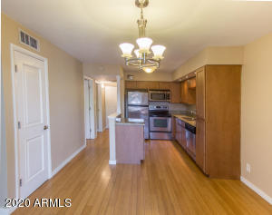 kitchen with granite counters and stainless steel appliances, fridge conveys with sale