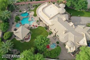 Staycation at home in style at this Custom gated 5 bedroom/4.5 Bath home with a private pool, slide, grotto, ramada and 2 spas!
