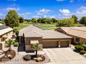 This gorgeous three car garage home offers a heated pool and spa, a welcoming floorplan, an incredible golf course view, and is located in a guard-gated active adult community!