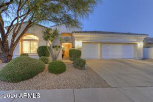 Stunning Home with low maintenance landscaping and a 3 car garage