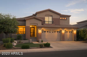 Desirable south facing backyard on interior homesite in Desert Ridge. Nice wide roads and sidewalks.